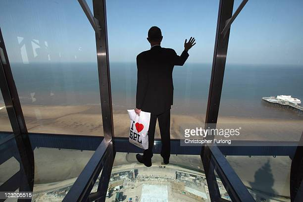 A visitor tries out the new glass Skywalk at the top of the refurbished Blackpool Tower on September 1 2011 in Blackpool England After a GBP £20...