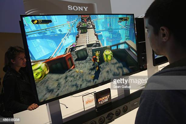 A visitor tries out the Ratchet and Clank video game at the Sony stand at the 2015 IFA consumer electronics and appliances trade fair on September 4...