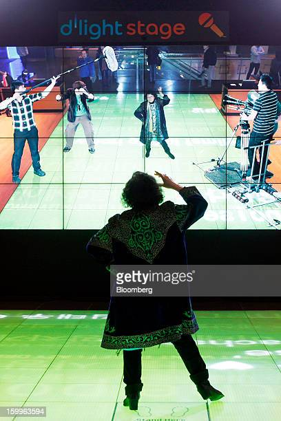 A visitor tries Samsung Electronics Co's Augmented Reality technology on the d'light stage at the Samsung d'light showroom and store in Seoul South...
