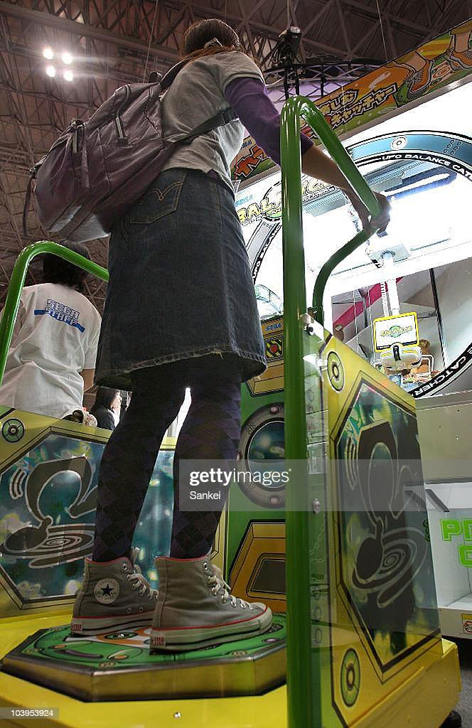 A visitor tries Sega's 'UFO Balance Catcher' during the 48th Amusement Machine Show at Makuhari Messe on September 9, 2010 in Chiba, Japan. The show, open until September 11, is for arcade video game machine industry, whose size of market has been shrinking year by year.