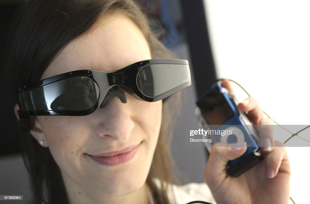 A visitor tries the ' Cinemizer Plus' video eyewear at the Carl Zeiss stand while at the CeBIT technology fair in Hanover, Germany, on Tuesday, March 2, 2010. Makers of software, computers and communications equipment from around the globe show new products at the annual show. Photographer: Ralph Orlowski/Bloomberg via Getty Images