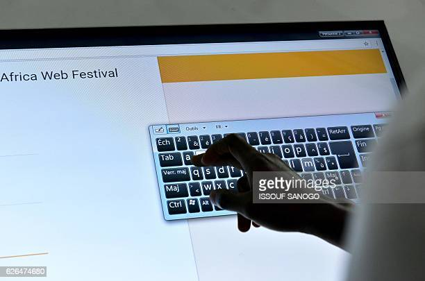 A visitor types the lettering 'Africa Web Festival' on a keyboard on an interactive display on the first day of the 2016 Africa Web Festival in...