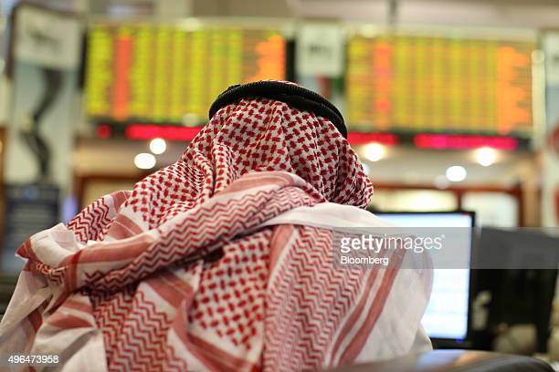 A visitor uses a computer terminal to access financial information at the Dubai Financial Market in Dubai United Arab Emirates on Tuesday Nov 10 2015...