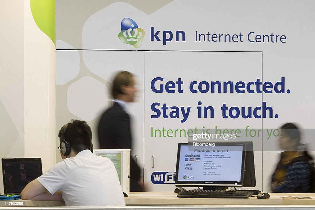 A visitor uses a laptop computer at a Royal KPN NV internet centre at Schiphol airport in Amsterdam, Netherlands, on Friday, July 6, 2012. America Movil SAB, Mexican billionaire Carlos Slim's wireless carrier, won the 28 percent stake it sought in Royal KPN NV, increasing its influence in Europe even after opposition from the Dutch operator. Photographer: Jock Fistick/Bloomberg via Getty Images