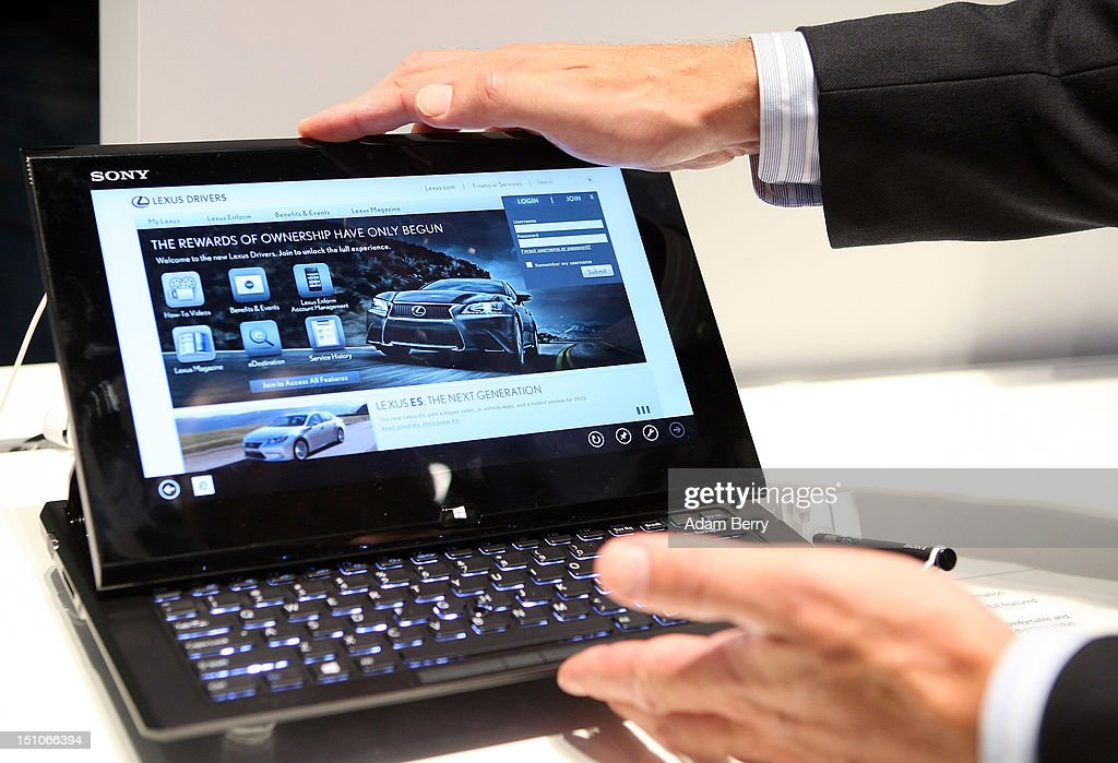 A visitor uses a Sony Slider Hybrid PC tablet computer during the Internationale Funkausstellung (IFA) 2012 consumer electronics trade fair on August 31, 2012 in Berlin, Germany. Microsoft, Samsung, Sony, Panasonic and Philips are amongst many of the brands showcasing their latest consumer electronics hardware, software and gadgets to members of the public from August 31 to September 5.