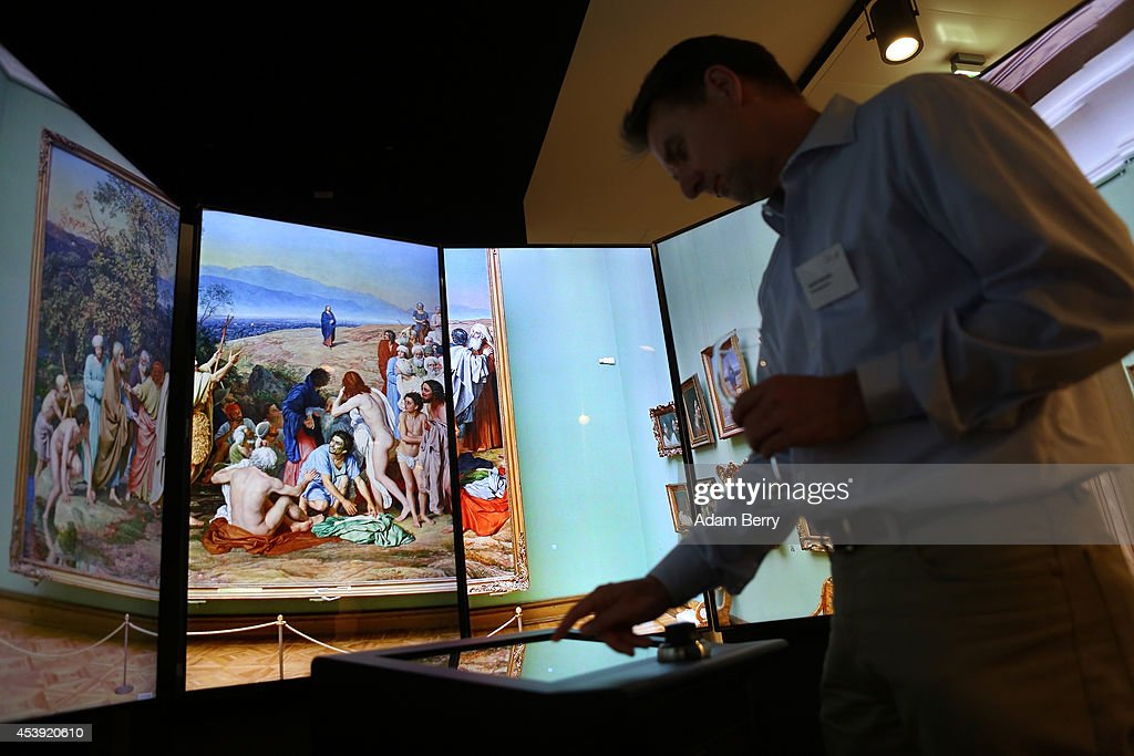 A visitor uses Google Earth software to browse an art museum's collection in the Google offices on August 21 2014 in Berlin Germany Google reported...