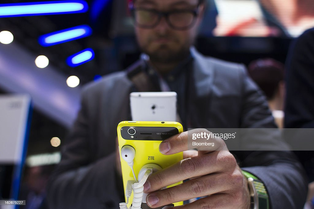 A visitor uses his mobile device to photograph a ZTE Corp. Grand S smartphone on display at the Mobile World Congress in Barcelona, Spain, on Monday, Feb. 25, 2013. The Mobile World Congress, where 1,500 exhibitors converge to discuss the future of wireless communication, is a global showcase for the mobile technology industry and runs from Feb. 25 through Feb. 28. Photographer: Angel Navarrete/Bloomberg via Getty Images
