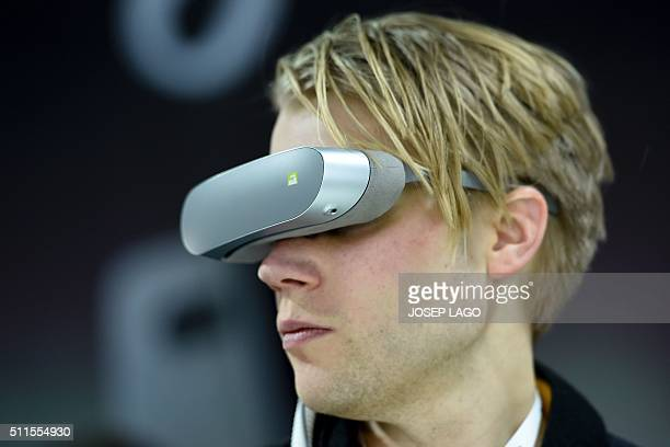 A visitor uses the LG 360 VR new model visual device by South Korean multinational conglomerate corporation LG following its presentation on the eve...
