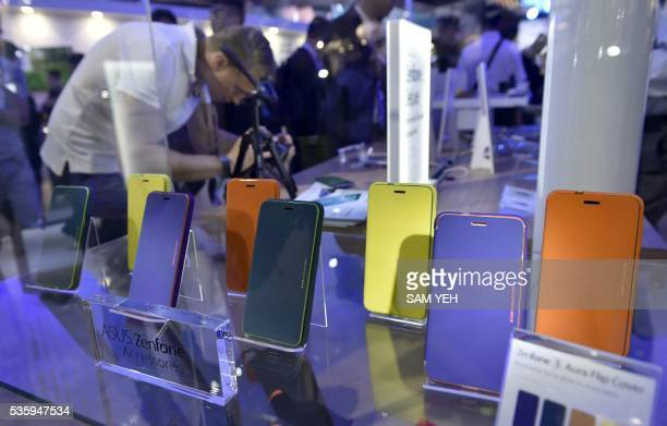 A visitor video the images behind the ASUS Zenphones during the annual Computex computer exhibition on May 31 2016 More then 5000 booths from thirty...