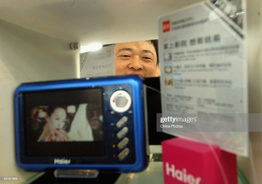 A visitor views a Haier DVD Player at the International Consumer Electronics Expo July 1, 2005 in Qingdao of Shandong Province, China. More than 310 domestic and overseas enterprises including Haier, Lenovo, Sony, Toshiba and Lucent attend the expo, showcasing new technology and products related to consumer electronics as well as the new trends of global industrial development.