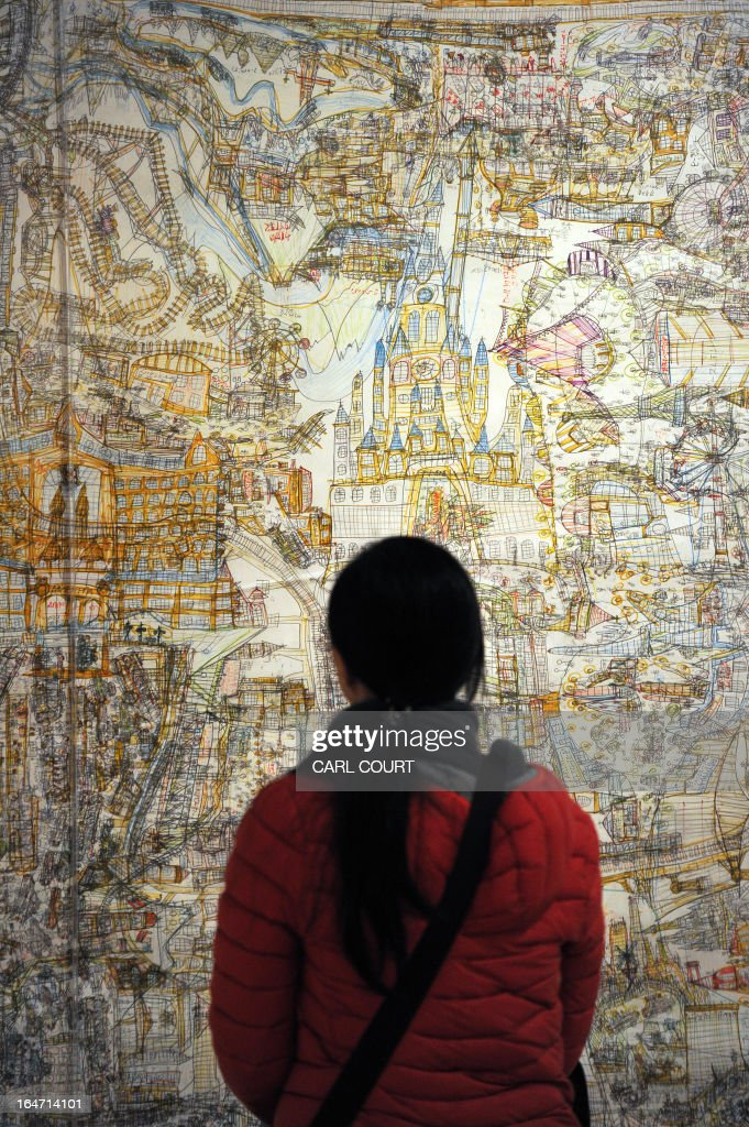 A visitor views an art work by Japanese artist Norimitsu Kokubo entitled 'Shanghai Disneyland of the Future' at the Wellcome Collection in central London on March 27, 2013. Forming part of the 'Souzou: Outsider Art from Japan' exhibition they are to be displayed from 28th March to 30th June 2013.