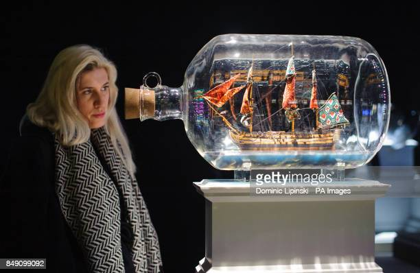 A visitor views 'Nelson's Ship in a Bottle' by artist Yinka Shonibare part of the 'Fourth Plinth Contemporary Monument' exhibition which showcases...