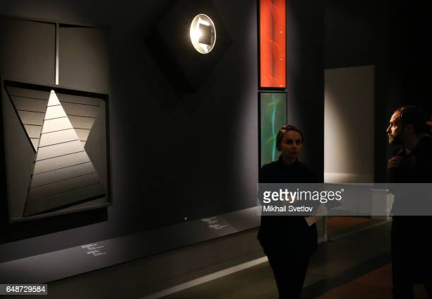 A visitor views the PostWar European Art Exhibition at Pushkin Museum in Moscow Russia March 6 2017 The exhibition includes more than 200 works by...