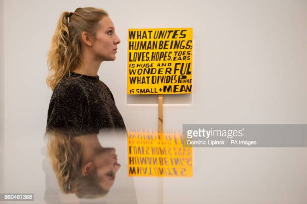 A visitor views 'What Unites Human Beings' by Bob and Roberta Smith valued at pound2500 to pound3 during a press preview for the forthcoming Art for...