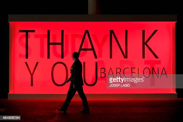 Visitor walk past mural billboards during the opening day of the 2015 Mobile World Congress in Barcelona on March 2 2015 Phone makers will seek to...