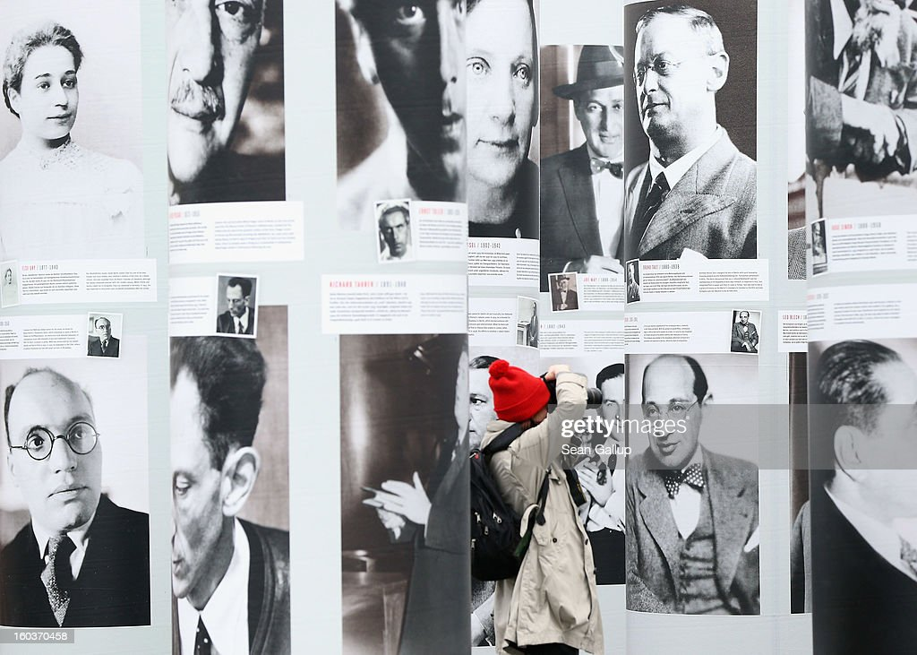 A visitor walks among portraits of Berlin Jews and political opponents persecuted, and in many cases murdered or driven to suicide, by the Nazis in the exhibition 'Diversity Destroyed' on January 30, 2013 in Berlin, Germany. The exhibition coincides with the 80th anniversary of the assumption of power by the Nazis with the appointment of Adolf Hitler as Reichskanzler, or Chancellor of the Empire.