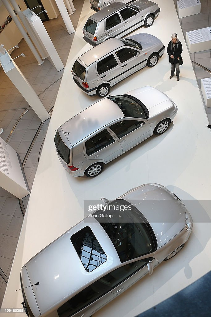 A visitor walks among previous generations of Volkswagen Golf cars at a Volkswagen Group showroom on January 14, 2013 in Berlin, Germany. Volkswagen Group, which includes the VW, Audi, Porsche, Skoda, SEAT, Bentley and Bugatti brands, delivered a record 9.07 million cars to customers in 2012. Rising sales in the Americas and Asia helped to offset a drop in sales in western Europe.