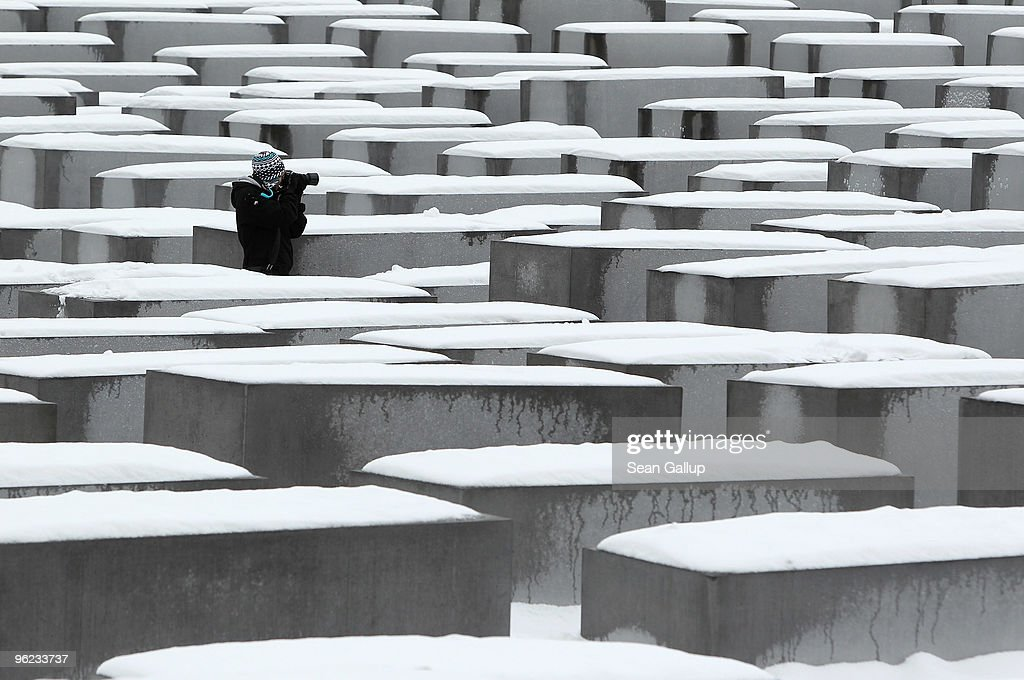 A visitor walks among snow-covered stellae at the Memorial to the Murdered Jews of Europe, also known as the Holocaust Memorial, on January 28, 2010 in Berlin, Germany. Though temperatures are mild today at around 0 degrees Celsius, northeastern Germany has struggled through a cold front in the last week that brought temperatures down to -20 degrees Celsius, and forecasters say they expect a second cold front to hit the region by the weekend.