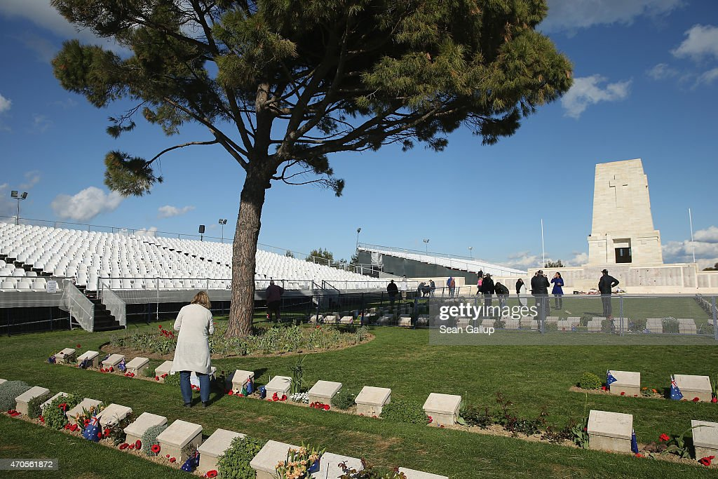 A visitor walks among the gravestones of Australian soldiers killed during the Gallipoli Campaign at the Lone Pine memorial ahead of commemoration...