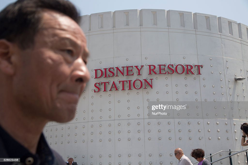 Visitor walks before the Disneyland Station in Pudong District in Shanghai, China. Disneyland Shanghai still under costruction and has planned to open on June 16, 2016.