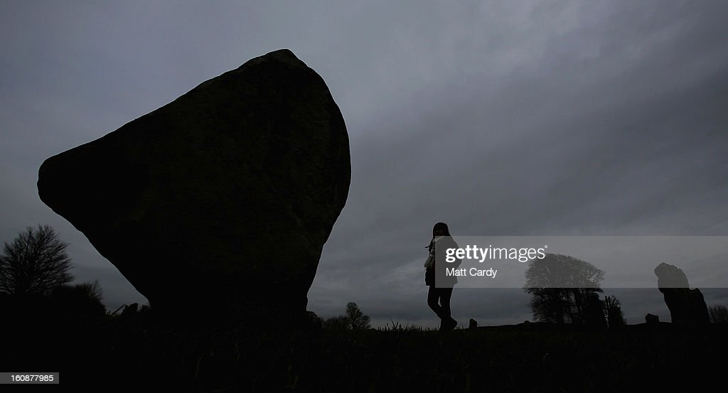 A visitor walks besides the Neolithic stones at Avebury on February 7, 2013 in Wiltshire, England. A leading travel magazine has recently named the collection of stones - thought to have been constructed around 2600BC and the largest stone circles in Europe, as the second best heritage site in the world. The Wiltshire world heritage site has been placed ahead of much more recognisable sites including the Valley of the Kings in Egypt, Taj Mahal in India and the Forbidden City in China.
