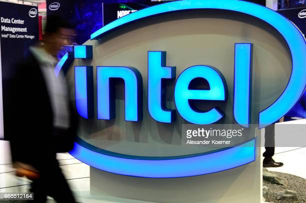 A visitor walks by the Intel stand at the CeBIT 2017 Technology Trade Fair on March 20 2017 in Hanover Germany Intel and BMW have produced a virtual...
