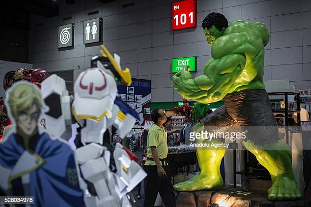A visitor walks front of the comics character Hulk during the Bangkok Comic Con 2016 Festival at Bitec Exhibition Centre in Bangkok Thailand on April...