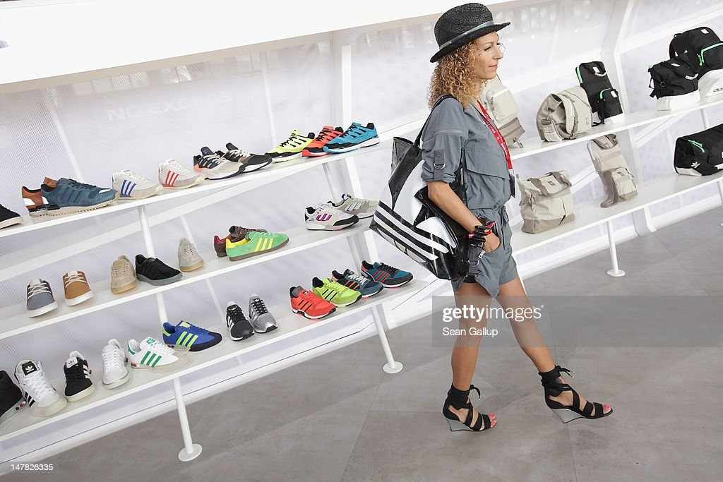 A visitor walks next adidas Originals shoes at the adidas Originals Spring/Summer 13 collection at the Bread and Butter 2012 fashion trade fair on July 4, 2012 in Berlin, Germany.