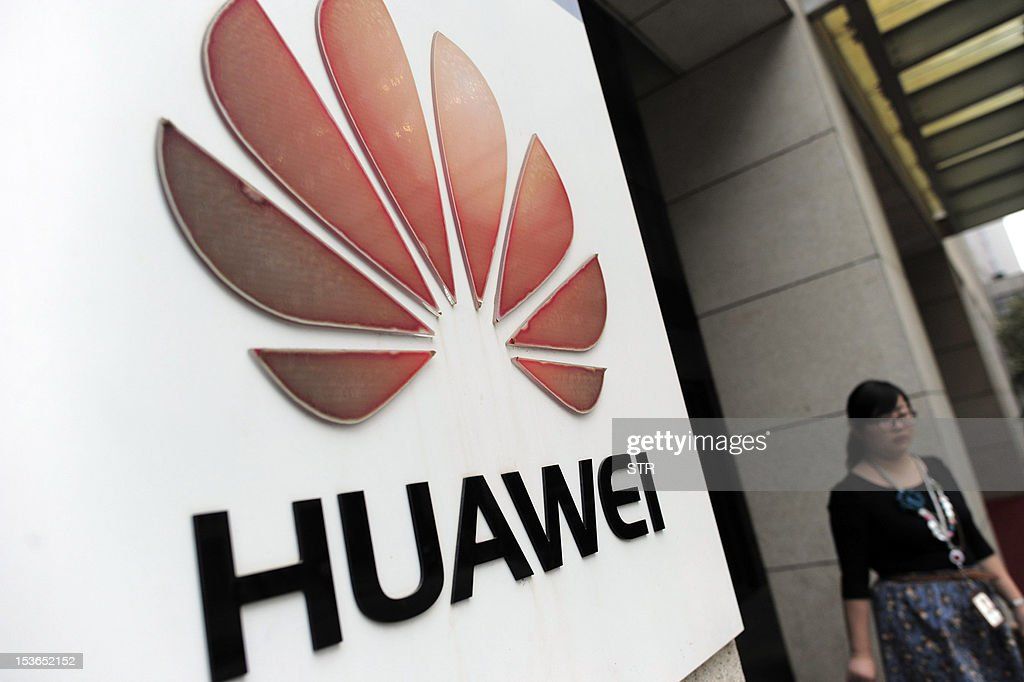 A visitor walks out from the entrance to the Huawei office in Wuhan, central China's Hubei province on October 8, 2012. Beijing on October 8 urged Washington to 'set aside prejudices' after a draft Congressional report said Chinese telecom firms Huawei and ZTE were security threats that should be banned from business in the US. CHINA
