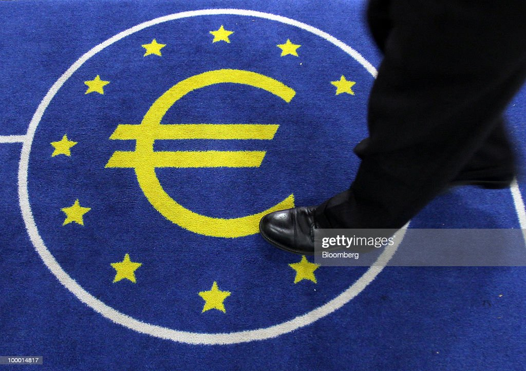 A visitor walks over the European Central Bank (ECB) logo, featuring a euro symbol, in Frankfurt, Germany, on Thursday, May, 20, 2010. Europe's debt crisis will depress the euro still further after it declined to the lowest level since 2006, according to UBS AG and BNP Paribas SA. Photographer: Hannelore Foerster/Bloomberg via Getty Images
