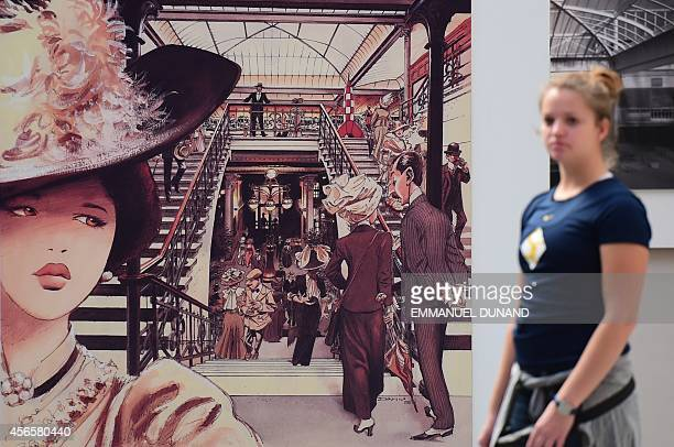 A visitor walks past a 1995 plate by Belgian cartoonist Dany in the 'Centre Belge de la Bande Dessinee' on October 3 2014 in Brussels as it marks its...