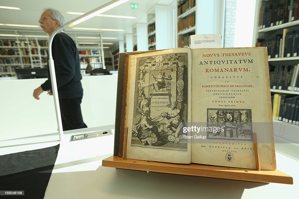 A visitor walks past a book from 1716 at the new Archaeology Center (Archaeologisches Zentrum) during the center's opening on October 31, 2012 in Berlin, Germany. The center, which houses archives, research, laboratory and restoration faicilites, will serve the city's five archaeological museums. Germany has a rich history of leading archaeological excavations across the globe.