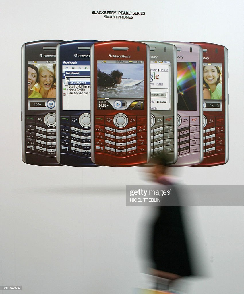 A visitor walks past a display of Blackberry 'Smart Phones' at the CeBIT trade fair in Hanover on March 7, 2008. The fair officially runs from 04 to 09 March and features some 5,000 exhibitors.