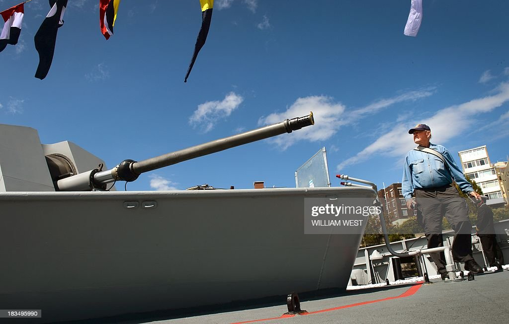 A visitor walks past a gun on the bow of the Indian warship INS Sahyadri at Royal Australian Navy's Sydney base of Garden Island, during an open day after the Australian Navy celebrated 100 years since their first ships entered Sydney Harbour, on October 7, 2013. The open day followed the Royal Australian Navy International Fleet Review which also included visiting warships from Britain, Singapore, Japan, India, Thailand and the United States. AFP PHOTO/William WEST
