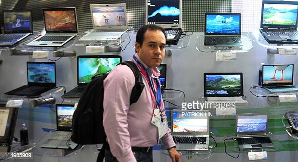 A visitor walks past a Microsoft booth on June 1 2011 on the second day of the fiveday Computex Taipei Asia's biggest information technology and...