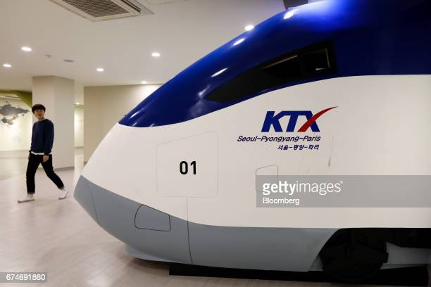 A visitor walks past a mockup of the Korea Train Express bullet train marked with SeoulPyongyangParis at the Odusan Unification Observatory near the...