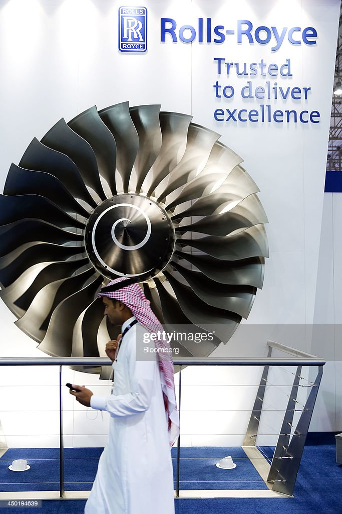 A visitor walks past a model of engine blades from a Rolls-Royce aero engine, manufactured by Rolls-Royce Holdings Plc., on display at the company's stand during the 13th Dubai Airshow at Dubai World Central (DWC) in Dubai, United Arab Emirates, on Sunday, Nov. 17, 2013. The 13th edition of the biennial 2013 Dubai Airshow, the Middle East's leading aerospace event organized by F&E Aerospace. Photographer: Duncan Chard/Bloomberg via Getty Images