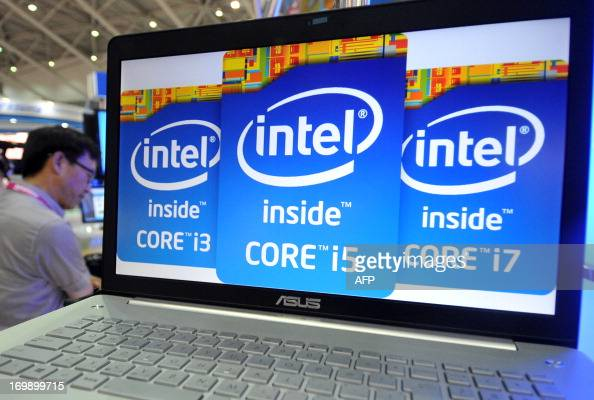 A visitor walks past a notebook showing the Intel logos during the 2013 Computex in Taipei on June 4 2013 Computex is Asia's biggest annual IT trade...