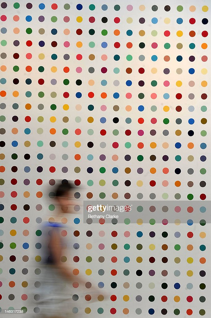 A visitor walks past a piece by Damian Hirst at Sotheby's on June 14, 2012 in London, England. This piece is part of the Impressionist & Modern and Contemporary Art sale at Sotheby's which will be held on June 19, 2012 and June 20, 2012.