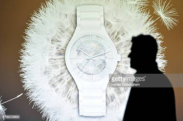 A visitor walks past a Rado watch display during Baselworld on March 16 2016 in Basel Switzerland Held annually Baselworld is the most important...