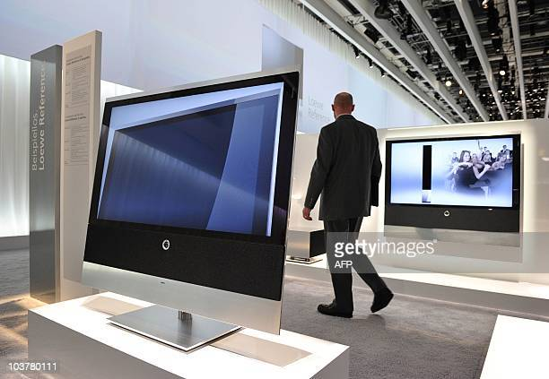A visitor walks past a 'Reference' 52 inch LCD TV on display at the booth of German high end TV manufacturer Loewe at the 50th edition of the 'IFA'...