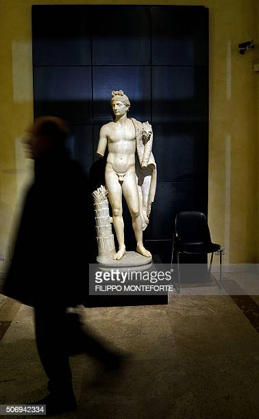 A visitor walks past a statue on display at Rome's Capitoline Museum on Capitol Hill on January 26 2016 Italy's desire to court visiting Iranian...