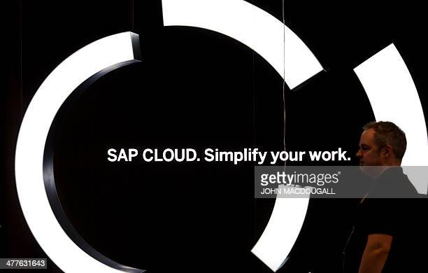 A visitor walks past an installation advertising SAP cloud solutions at the stand of German software giant SAP at the 2014 CeBIT computer technology...