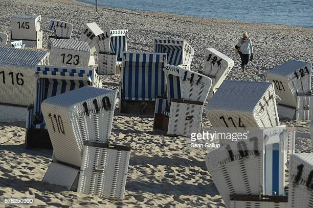 A visitor walks past beach chairs along the northern end of Sylt Island on July 19 2016 near List Germany Sylt Island with its long stretches of sand...