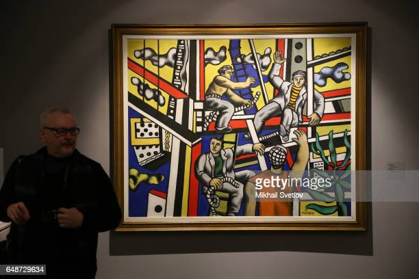A visitor walks past Fernand Leger's 'Builders with Aloe' is seen at the PostWar European Art Exhibition at Pushkin Museum in Moscow Russia March 6...