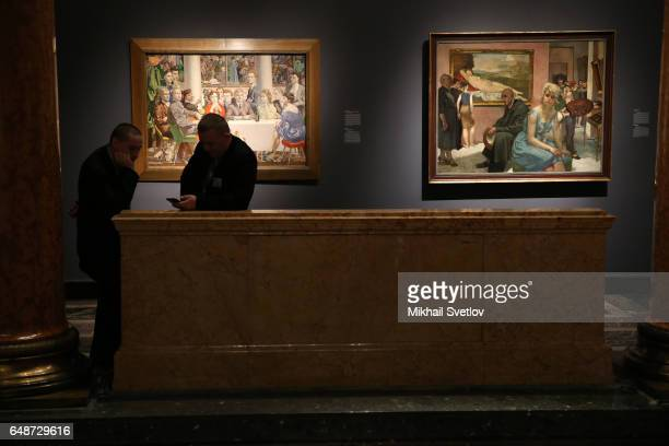 A visitor walks past Hans MayerForeyt's 'In the Museum' is seen at the PostWar European Art Exhibition at Pushkin Museum in Moscow Russia March 6...