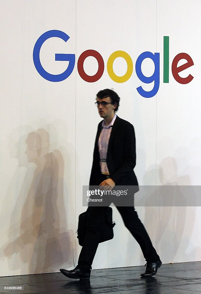 A visitor walks past in front of a Google logo during the Viva Technology show on June 30, 2016 in Paris, France. Viva Technology Startup Connect, the new international event brings together 5,000 startups with top investors, companies to grow businesses and all players in the digital transformation who shape the future of the internet.