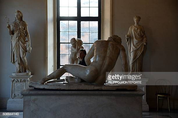 A visitor walks past marble statues on display at Rome's Capitoline Museum on Capitol Hill on January 26 2016 Italy's desire to court visiting...