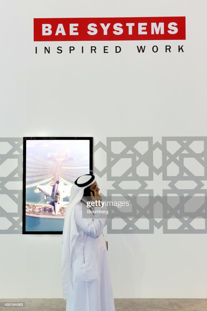 A visitor walks past the BAE Systems Plc., exhibition stand on show at the 13th Dubai Airshow at Dubai World Central (DWC) in Dubai, United Arab Emirates, on Sunday, Nov. 17, 2013. The 13th edition of the biennial 2013 Dubai Airshow, the Middle East's leading aerospace event organized by F&E Aerospace. Photographer: Duncan Chard/Bloomberg via Getty Images