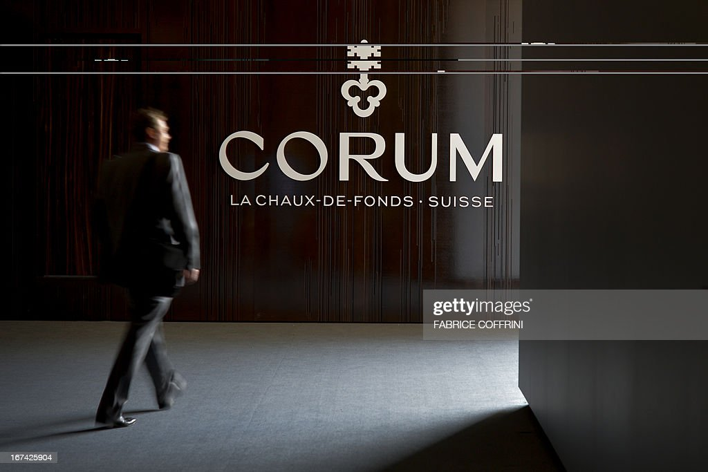 A visitor walks past the booth of Swiss watchmaker Corum, bought by Chinese group China Haidian, on the opening day of watch fair Baselworld on April 25, 2013 in Basel. The world's biggest watch fair Baselworld, which this year will host 1,460 exhibitors, including leading brands like Rolex, Patek Philippe and Omega, and is expected to draw some 100,000 visitors.
